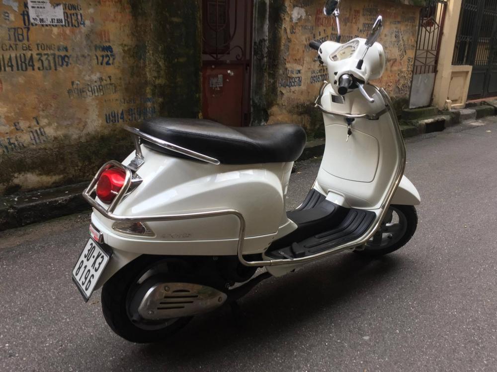 Vespa LX125 VN bs 30K mau Trang thoi trang 22500tr chinh chu di giu nguyen ban