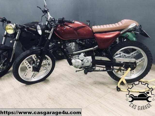 Locin wolf lien doanh 110cc do tracker CAS Garage